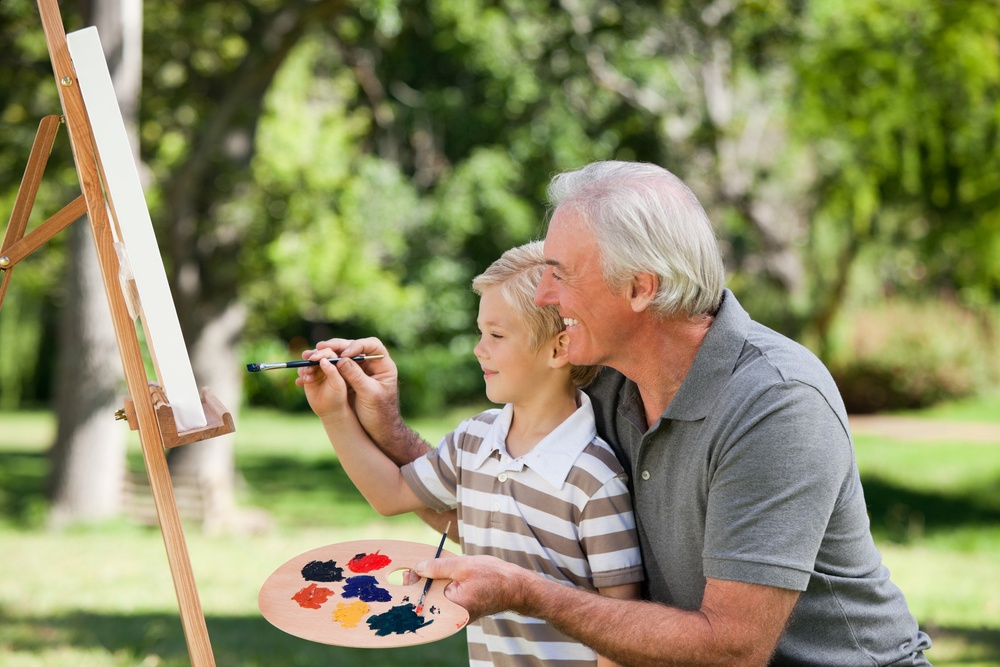 Grandfather painting with his grandson.jpeg